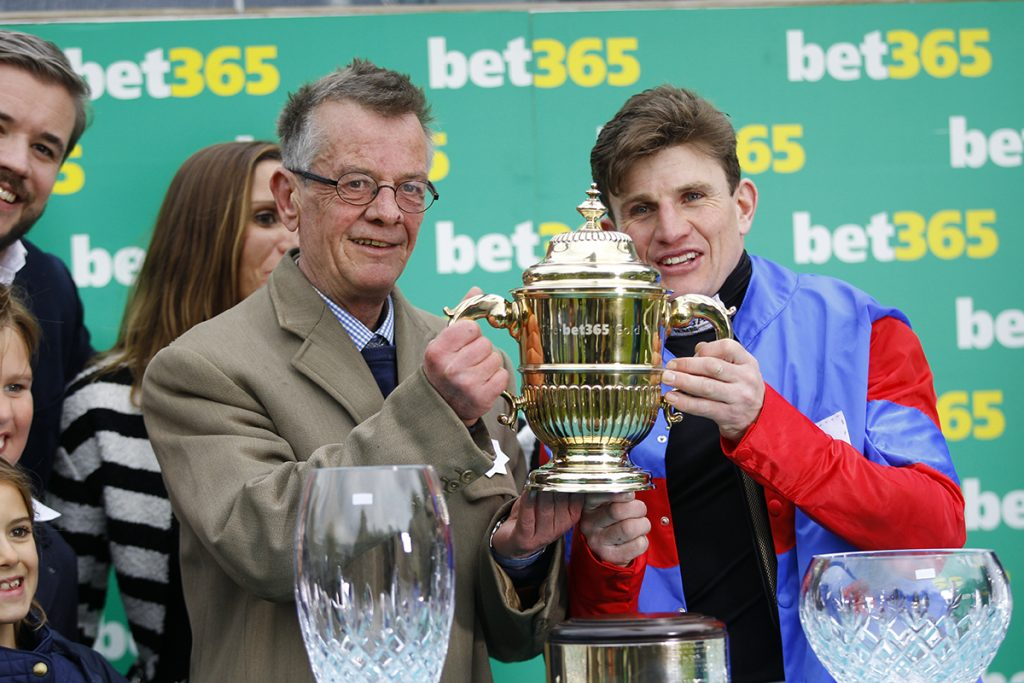 Mark Bradstock and Jamie Moore celebratring Step Back's win at Sandown